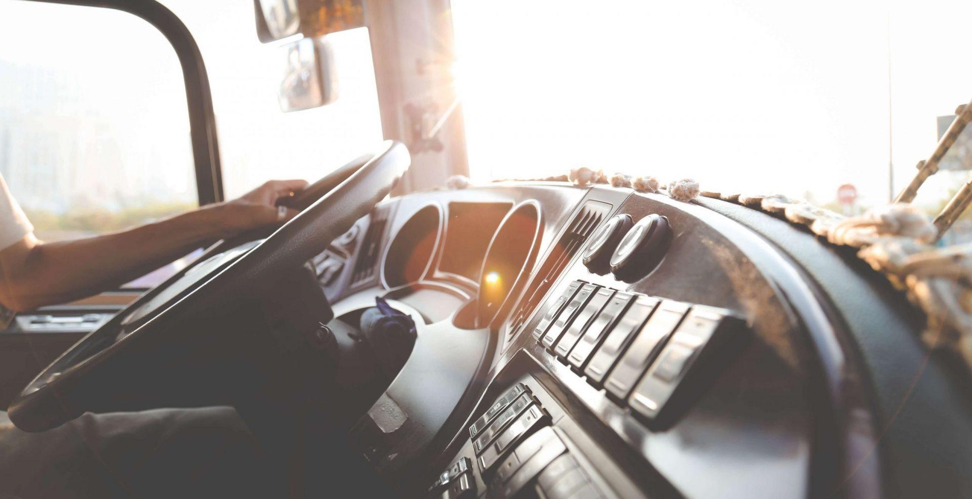Mental Health Tips for Truckers Hand on Steering wheel in semi