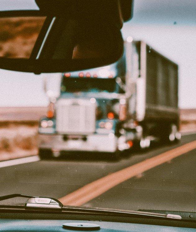 Truck on Road Through Windshield